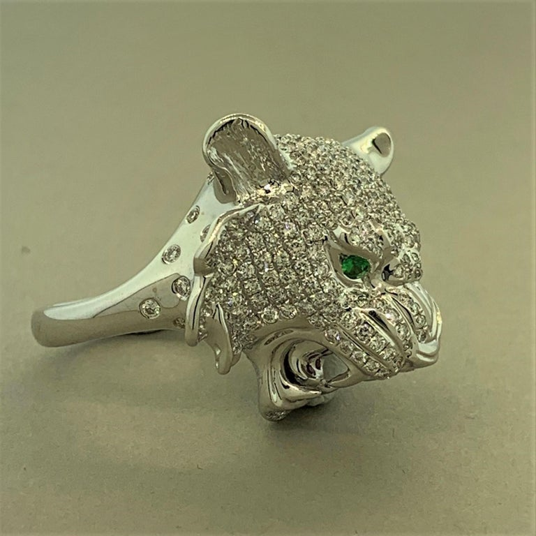 The fierce king of the jungle is studded with 3.83 carats of round brilliant cut diamonds making this fantastic piece. There are two tsavorite garnets which make up its eyes and there are rubies set in its mouth. Soft to the touch and full of detail
