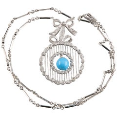 Diamond and Turquoise Necklace with Ribbon Bow Design Set in 18 Karat White Gold