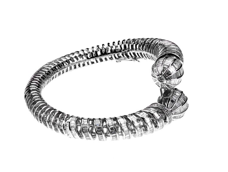 Modern Diamond Twist Bangle with Round Brilliant & Baguette Cut in 18 Karat White Gold For Sale