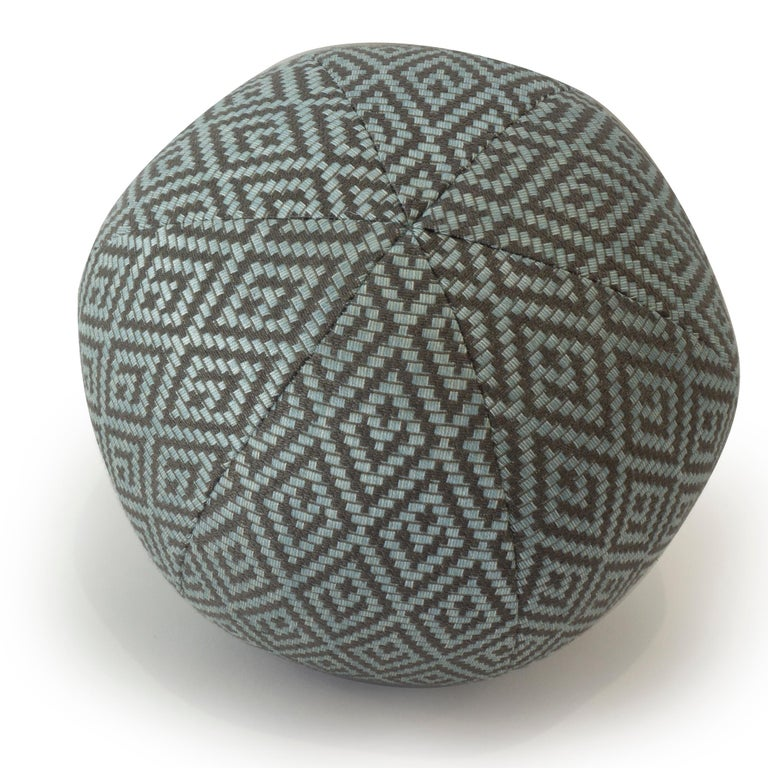 A round ball shaped pillow hand sewn in a blue diamond patterned weave fabric.  Measurements: 12