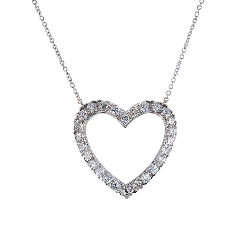 Estate diamond and white gold heart shaped pendant necklace circa 1950.   Love it because it caught your eye, and we are here to connect you with beautiful and affordable jewelry.  It is time to claim a special reward for Yourself!  Clear and