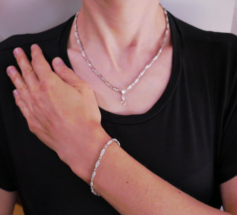 Classy and timeless Art Deco revival diamond necklace that turns into a shorter necklace and a bracelet. It also has an enhancer and you can dress it up with pendants that you already have. Elegant, versatile and wearable, the necklace is a great
