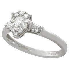 Diamond White Gold Solitaire Ring with Accents