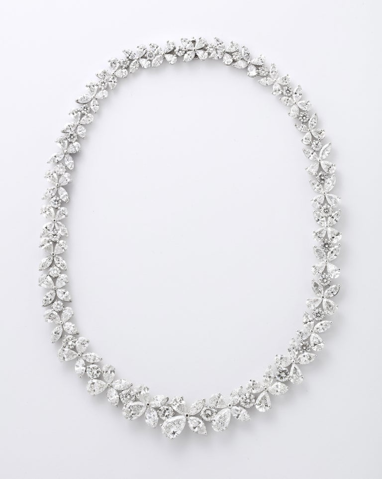 An important diamond wreath necklace.   76.82 carats of white pear, marquise and round brilliant cut diamonds set in platinum.   An incredible necklace -- full of sparkle -- featuring diamonds from 1 to over 2 carats in the center.  The center link