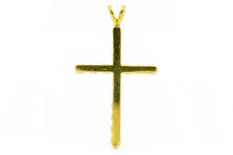 Elegant classic 14k yellow gold diamond cross featuring 16 nice quality diamonds weighting approximately .05 carats each for a total weight of .80 carats in diamonds.  The cross has a rabbit ear on top for you to put your chain through the hole for