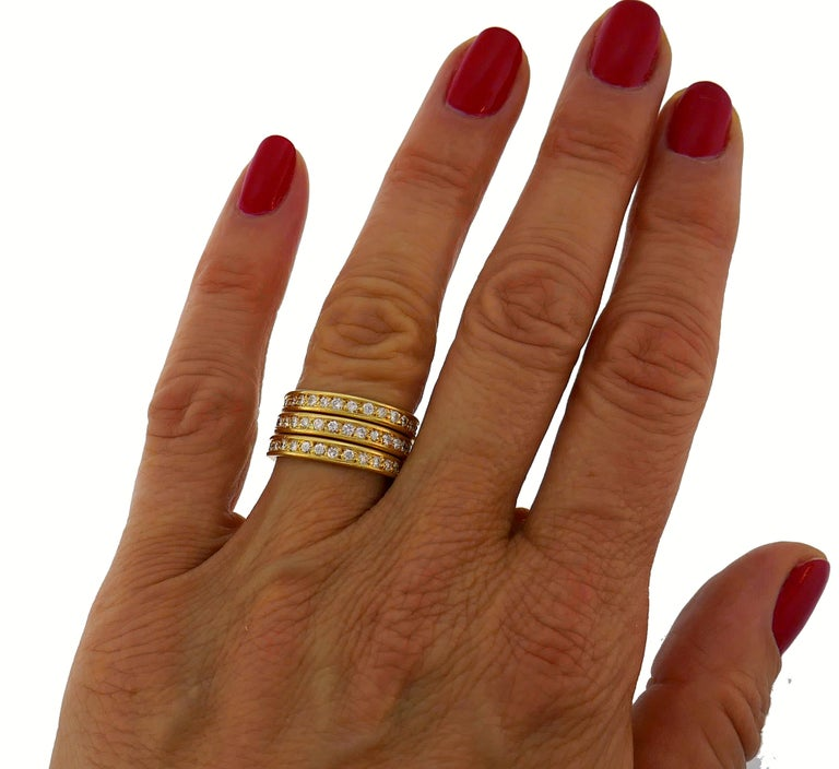 A trio of classy and timeless eternity bands created in France in the 1970s.  They are made of 18 karat yellow gold and each is set with twenty nine round brilliant cut diamonds (G-H color, VS clarity, total weight approximately 1.30 carats).  The