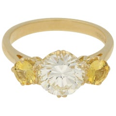 Diamond and Yellow Sapphire Ring in 18 Carat Yellow Gold
