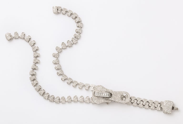 The most luxurious and decadent zipper that you have ever seen, this fully diamond set bracelet is a unique piece.  The jeweled zipper is a period design made by some of the famous French maisons, and generally seen as a necklace.  With nearly 5cts