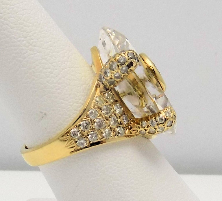 Very Stylish 18 Karat Yellow Gold Ring with 1 Round Brilliant Fancy Yellowish Brown Diamond, 0.70 Carat SI, 92 Round Brilliant Diamonds, 1.04 Carat Total Weight SI-1, H, and Hexagonal Faceted Quartz. Size: 6.5. 6.3 DWT or 12.90 Grams.