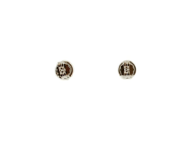 Elegant stud earrings in 18 kt white gold structure mounted with a central diamond surrounded by little white diamonds. These earrings are totally handmade by Italian master goldsmiths. Diamonds 0.42 ct, brilliant cut, G Color, VS Clarity Total
