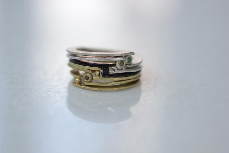 Simplicity With A Twist ring, yellow and brown color diamonds set in 18K Gold fashion band. This unisex combination would make an interesting bridal or a wedding ring. Ideal as a woman's or men's.  These striking rings are first hand forged in 21k