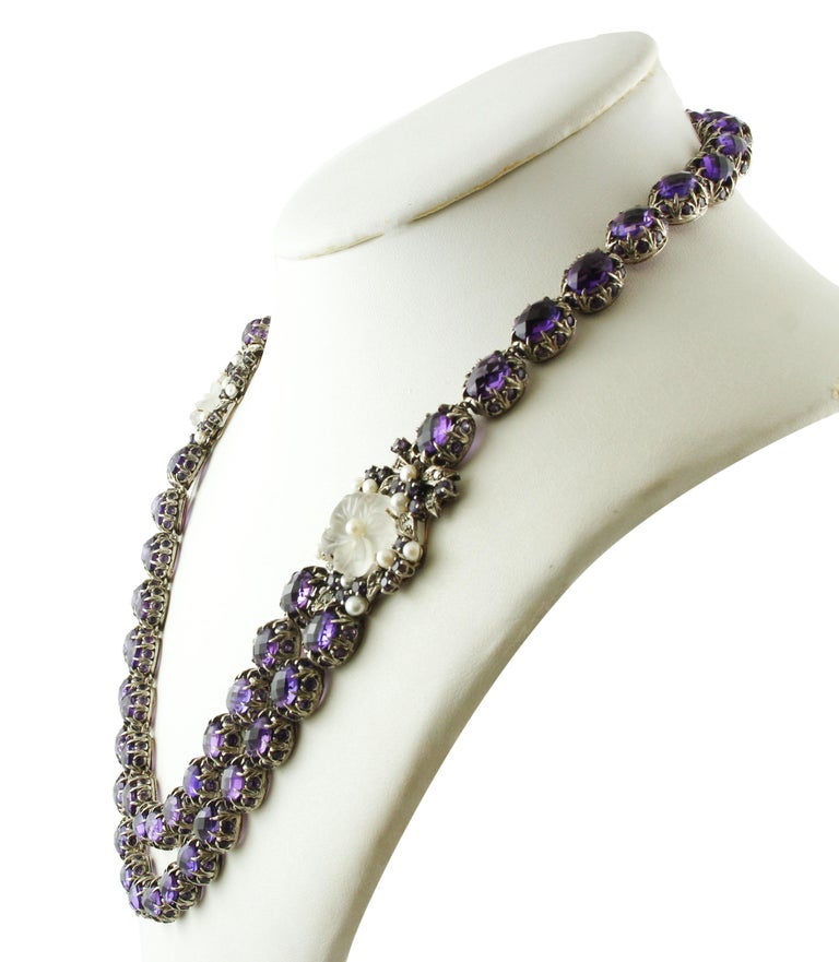 Gorgeous retrò multi-strand necklace realized in 9K rose gold and silver structure mounted with one amethysts row with little amethyst around at the top and two amethysts rows with little amethysts around at the bottom, embellished on the two sides