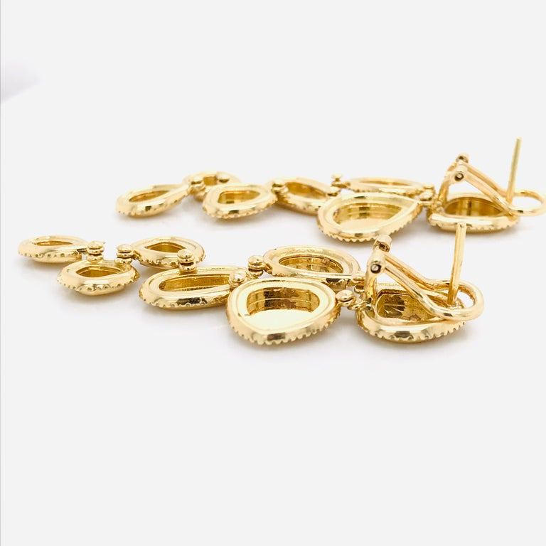 Brushed Yellow Gold  18 k chandelier earrings Weight of Gold 19.64 gr  Diamonds 1.71 carat Dimensions length 5.55 cm width 2.2 cm