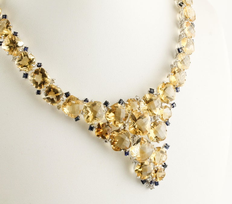 Amazing white gold semi-rigid necklace embellished with beautiful yellow topaz and diamonds and blue sapphires detailes Diamonds 1.75 ct Blue Sapphires 8 ct  Topazes 154.31 ct  Total Weight 75.20 R.F + gfcor Length 20.5 cm (close)  For any enquires,