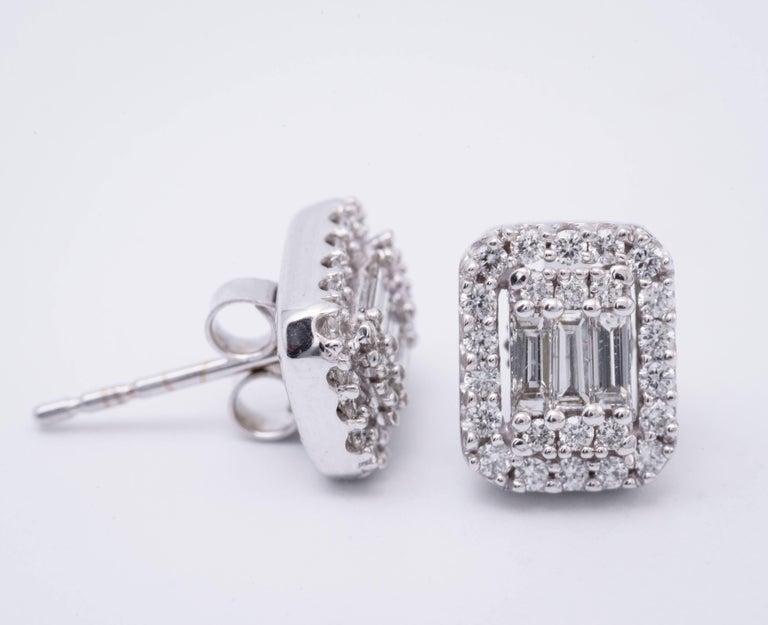 14K Diamond studs earrings  Diamond weight: 0.63 Cts. Earrings measuring: 9 x 7 mm