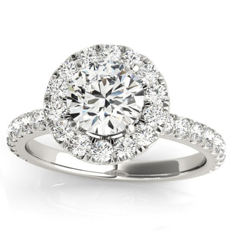 Shimmering white diamonds dance delicately along the shank and surround the halo of this Valorenna one of a kind engagement ring. The GIA certified center stone shines admirably and appears bigger in this halo setting.  Matching Band Is Not