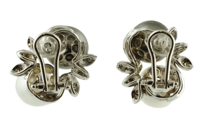 Beautiful pair of earrings realized in 14k white gold structure, mounted with 2 pearls and flower decoration in white gold studded with diamonds.  These earrings are totally handmade by Italian master goldsmiths Diamonds 0.7 ct South sea Pearls
