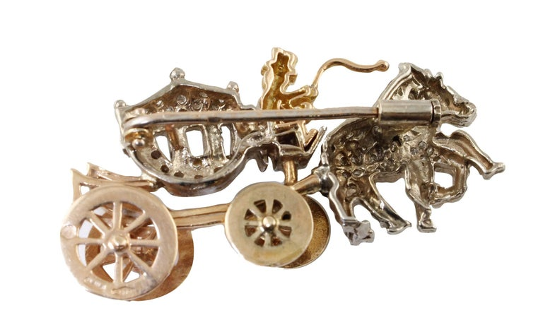 Beautiful brooch in 14 kt white and rose gold, which represents a fabulous carriage with two horses and a coachman, all studded with diamonds, just like in fairy tales.  Diamonds ct 0.60 Total weight g 11.00 R.F + gcfh  For any enquires, please
