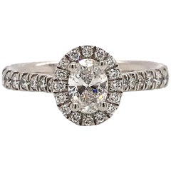 Diamonds Round Cut and Oval Cut on Platinum Engagement Ring