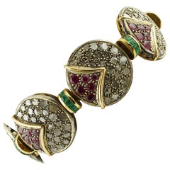 Diamonds, Rubies, Emeralds, 18 Karat Rose Gold and Silver Retro Bracelet