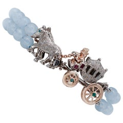 Diamonds Rubies Emeralds Sapphire Aquamarine 9 Gold and Silver Carriage Bracelet