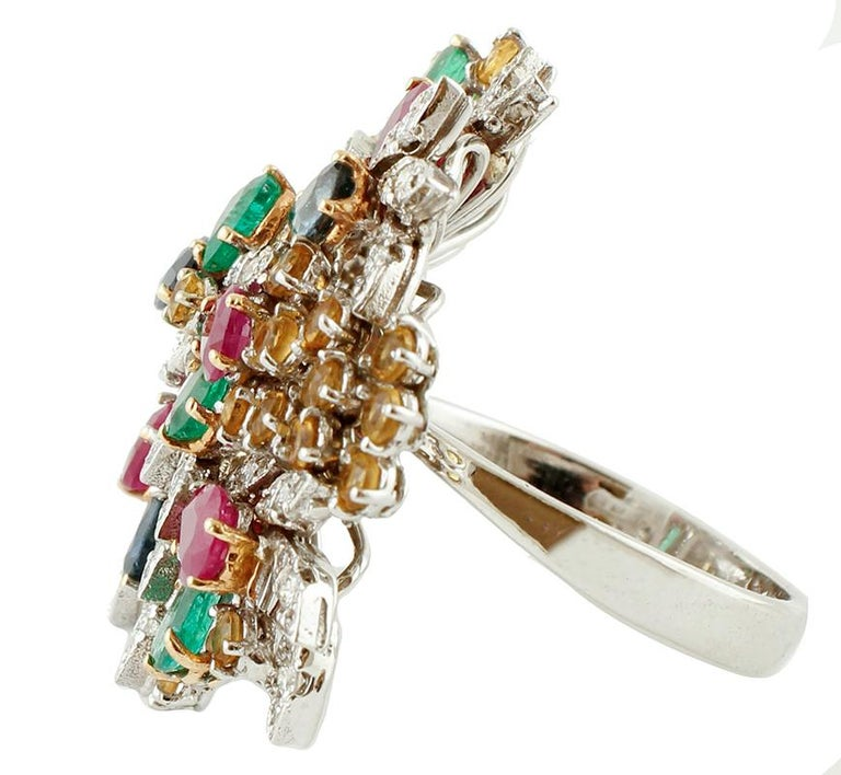 Vintage ring in 14k white gold structure with flowery design, studded with diamonds, rubies, emeralds and sapphires. The origin of this ring goes back to the 1980s, it was totally handmade by Italian master goldsmiths and it is in perfect