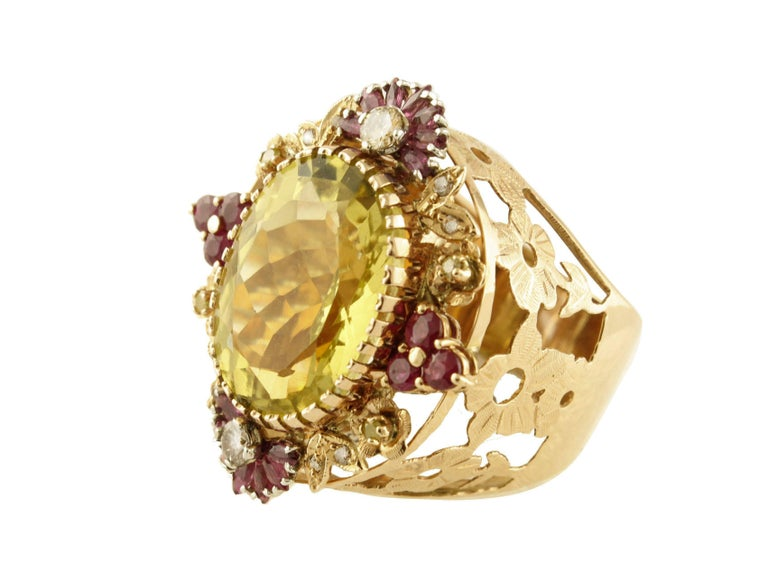 Amazing flower theme cocktail ring in 14K rose gold composed by a magnificent lemon citrine (1.6 cm X 2.1 cm) in the center surrounded by leaves and flowers details in 14K rose gold studded by precious diamonds and rubies Diamonds 0.54 ct  Rubies