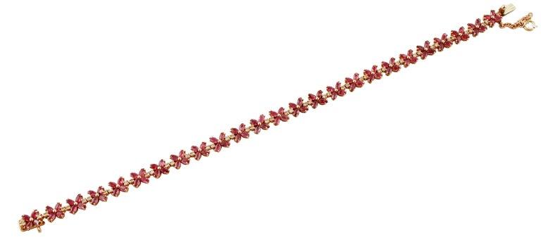 Retro Diamonds, Rubies, Rose Gold Flower Shape Link Tennis Bracelet For Sale