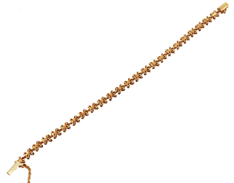 Diamonds, Rubies, Rose Gold Flower Shape Link Tennis Bracelet In Good Condition For Sale In Marcianise, Caserta