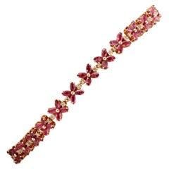 Diamonds, Rubies, Rose Gold Flower Shape Link Tennis Bracelet