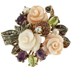 Diamonds Rubies Sapphires Amethyst Peridots Pearls Coral Gold and Silver Ring