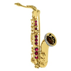 Diamonds Rubies Saxophone 18 karat Yellow Gold Brooch