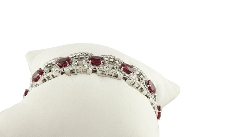 Charming bracelet in 14 kt white gold, length 18 cm embellished with fabulous 23.25 ct of rubies surrounded by 6.48 ct of white diamonds. Total weight 42 g Diamonds ct 6.48 Rubies ct 23.25 Total weight g 42.18  RF + giurr Length 18 cm  For any