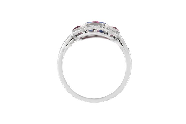 The ring is finely crafted in platinum with diamonds weighing approximately total of 1.00 carat ,ruby weughung approximately total of 1.20 carat and sapphire weighing approximately total of 1.00 Circa 1950 Size 6.45 (easy to resize )