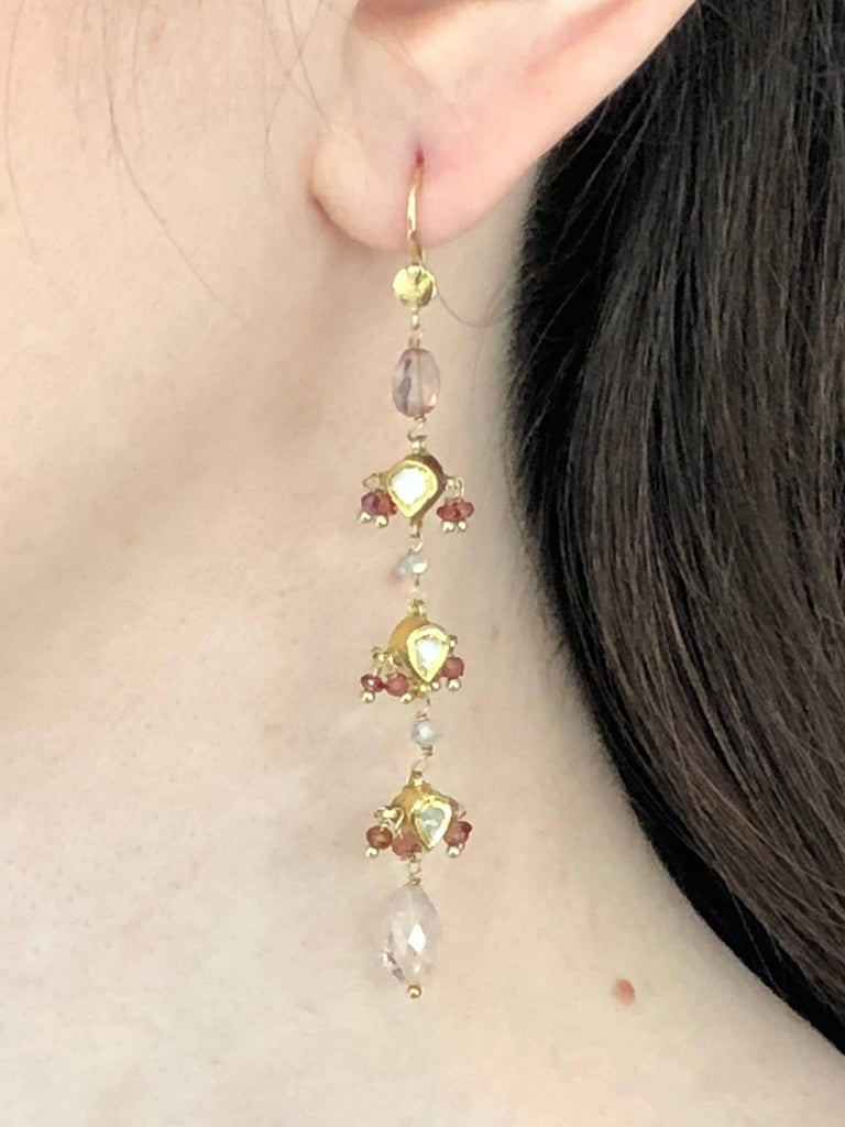 Customized dangling earrings made with vintage 18k gold pendants, enamelled in the back , rose cut diamonds in front, rubies and light pink tourmalines briolette cut, saphires on 14K gold setting.  Limited edition.  Brand : 5 OCTOBRE Designer :