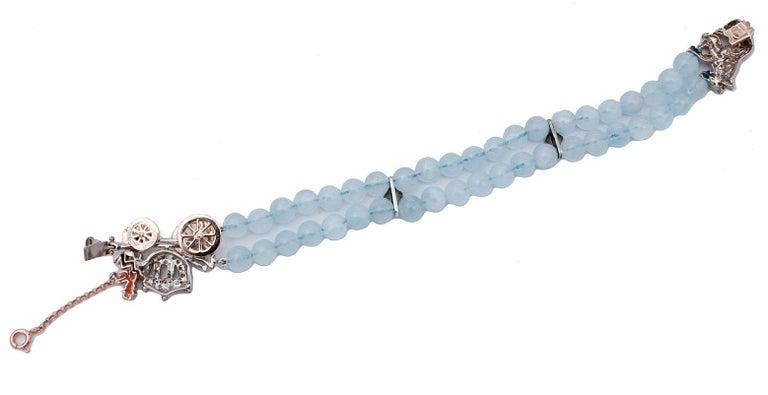 Retro Diamonds Rubies Emeralds Sapphire Aquamarine 9 Gold and Silver Carriage Bracelet For Sale