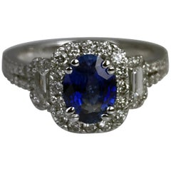 DiamondTown 1.22 Carat Oval Cut Sapphire and 0.83 Carat Diamond Ring