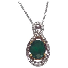 DiamondTown 1.26 Carat Oval Cut Emerald and 0.22 Carat Diamond Pendant
