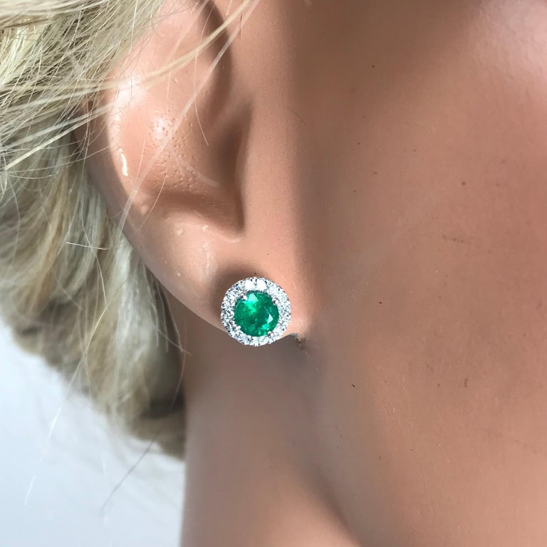 Round Cut DiamondTown 1.3 Carat Round Emerald and Diamond Earrings in 14k White Gold For Sale