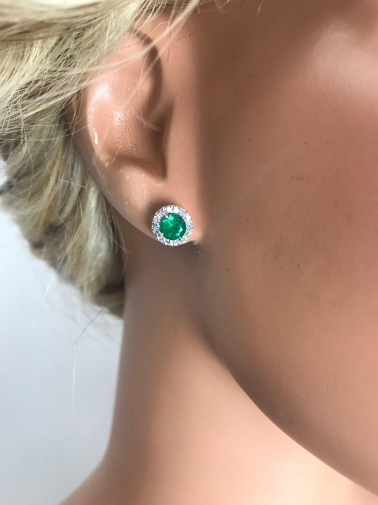 DiamondTown 1.3 Carat Round Emerald and Diamond Earrings in 14k White Gold In New Condition For Sale In New York, NY