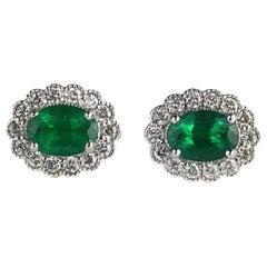DiamondTown 1.58 Carat Oval Cut Emerald and 0.5 Ct Diamond Halo Flower Earrings