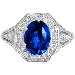 DiamondTown 2.02 Carat Oval Cut Fine Blue Sapphire and Diamond Ring