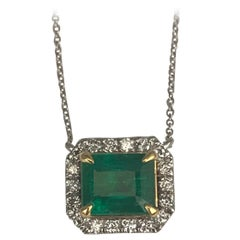 DiamondTown 2.33 Carat Emerald Cut Emerald Pendant with 0.32 Carat Diamond Halo