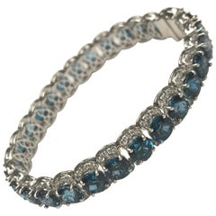 DiamondTown 31.33 Carat Step Cut Blue Topaz and 3.1 Carat White Diamond Bracelet