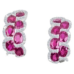 DiamondTown 3.28 Carat Oval Cut Ruby Lever-Back Earrings in White Diamond Halo