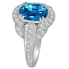 DiamondTown 3.34 Carat Oval Cut Blue Zircon and Diamond Halo Ring
