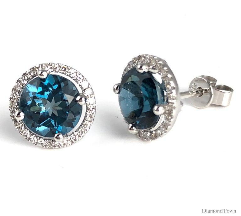 Contemporary Diamond Town 3.58 Carat London Blue Topaz Halo Stud Earrings in 14 Karat Gold For Sale