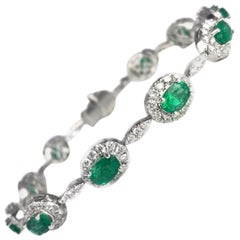DiamondTown 4.63 Carat Oval Cut Emerald and Diamond Bracelet in 18 Karat Gold