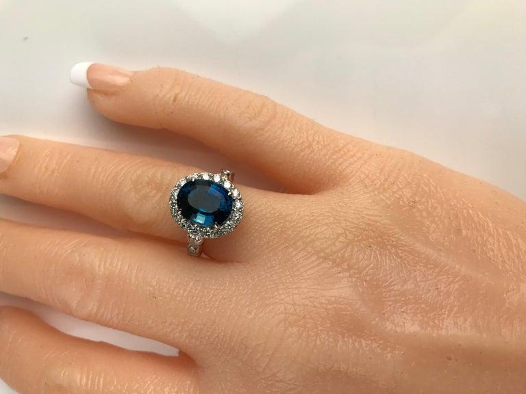 Contemporary Diamond Town 5.35 Carat Blue Topaz and 1.32 Carat Diamond Ring in 14 Karat Gold For Sale