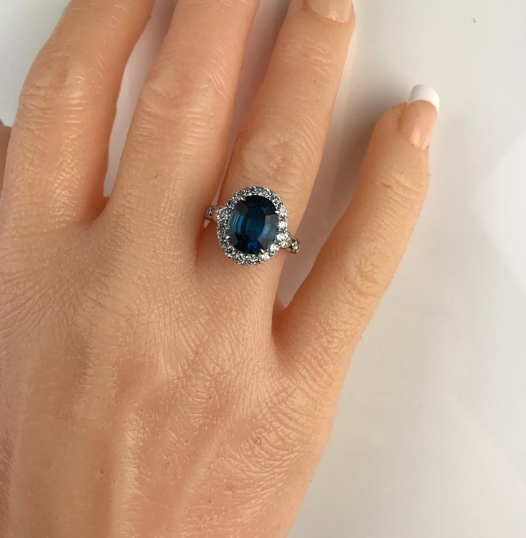 Oval Cut Diamond Town 5.35 Carat Blue Topaz and 1.32 Carat Diamond Ring in 14 Karat Gold For Sale